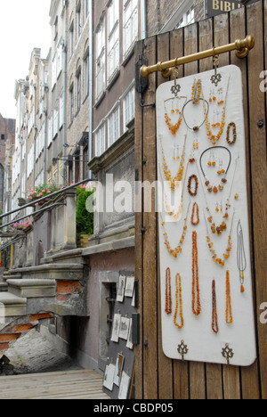 Jewellery made from Baltic Sea amber on sale in the old town of Gdansk, Pomerania, Poland - Stock Photo