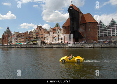 View from Oliwianka towards Stare Miasto, the old town of Gdansk, Danzig, with car-shaped fun boat on the Motlawa - Stock Photo