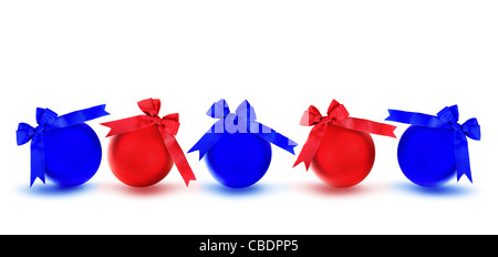 Red and blue baubles with bows, Christmas tree ornaments and holiday decorations isolated on white background - Stock Photo