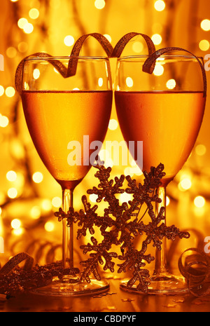 Romantic holiday drink, celebration of Christmas or new year eve, party with Champagne and festive gold ornament - Stock Photo
