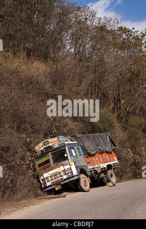 India, Nagaland, Kohima, Truck in ditch on main highway to Imphal - Stock Photo