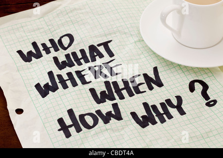 what, when, where, why, how, who questions - black marker handwriting on a grid paper with a coffee cup - Stock Photo