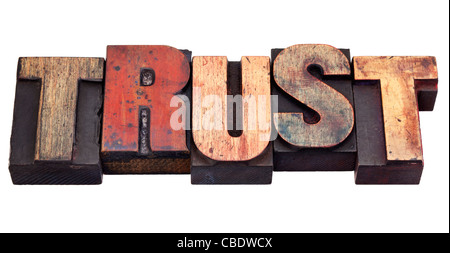 trust word in vintage grunge wooden letterpress printing blocks, isolated on white - Stock Photo