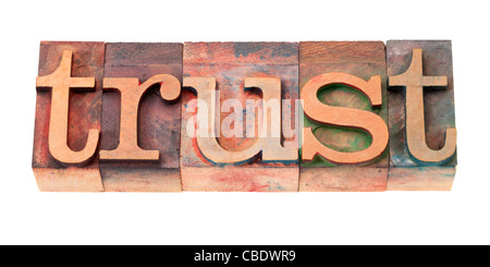 trust word in vintage wooden letterpress printing blocks, stained by color inks, isolated on white - Stock Photo
