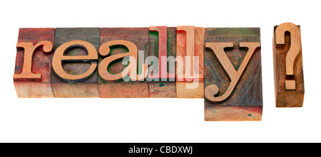 really question or doubt concept - word in vintage wooden letterpress printing blocks, stained by color inks, isolated - Stock Photo