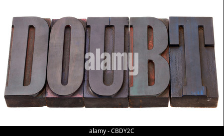 doubt - word in vintage wooden letterpress printing blocks, stained by color inks, isolated on white - Stock Photo