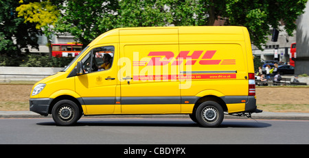 DHL express parcel delivery van and driver in yellow van a division of the German logistics company Deutsche Post - Stock Photo