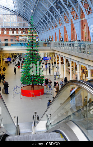St Pancras International interior of train station with indoor Christmas tree formed from Lego bricks in retail - Stock Photo