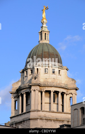Bronze statue sculpture Lady Justice or Scales of Justice above copper clad roof at Old Bailey courthouse Central - Stock Photo