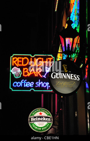Neon signs at night in Red-light district, Amsterdam, Noord Holland, Netherlands - Stock Photo
