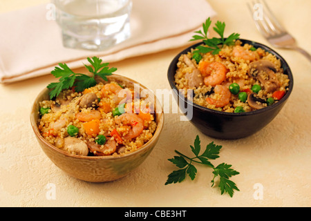 Couscous with prawns and mushrooms. Recipe available. - Stock Photo
