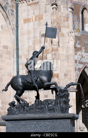 Statue in the front of the St Vitus cathedral in Prague old city - Stock Photo
