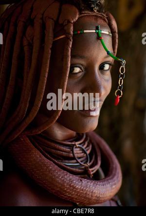 Himba Woman Called Mucaniama Wearing A Plastic Jewel, Village Of Hoba Haru, Angola - Stock Photo