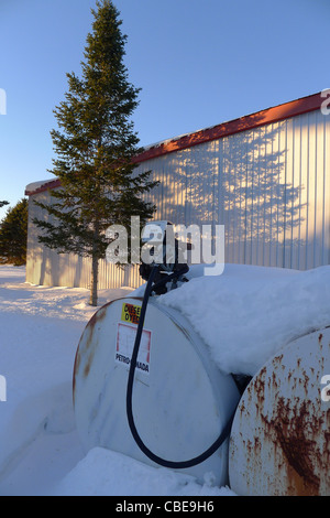 A snow covered diesel pumping station on a farm in rural Canada - Stock Photo