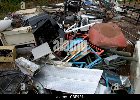 A pile of different varieties of scrap metal ready to be processed and reused at a recycling depot - Stock Photo