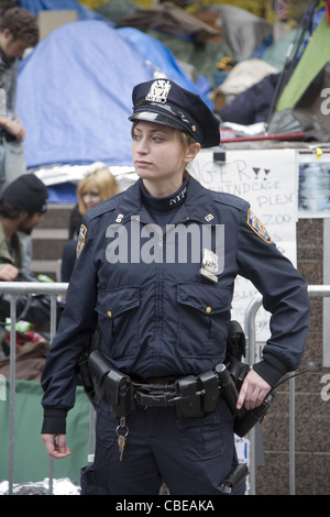 Female NYPD officer assigned to the Occupy Wall Street encampment. - Stock Photo