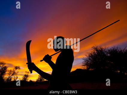 Mucubal Boy With Omotungo Knife At Sunset, Virie Area, Angola - Stock Photo