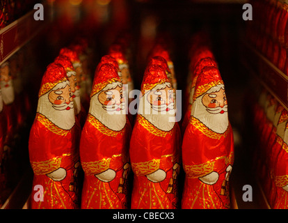 Chocolate figures of Santa Claus displayed in a supermarket. - Stock Photo
