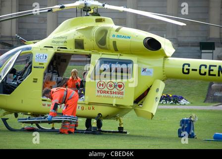 Sheffield Air Ambulance Helicopter unloading in Weston Park, Sheffield, UK - Stock Photo