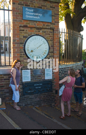 People at The Shepherd 24 Hour Gate Clock outside Royal Observatory Museum in Greenwich borough London England UK - Stock Photo
