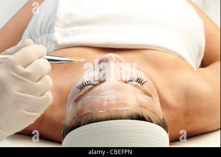 Woman getting a facial treatment at a spa. - Stock Photo