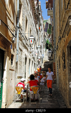 DUBROVNIK, CROATIA. Customers eating at a gelateria on a narrow side street off Stradun in the walled old town. - Stock Photo