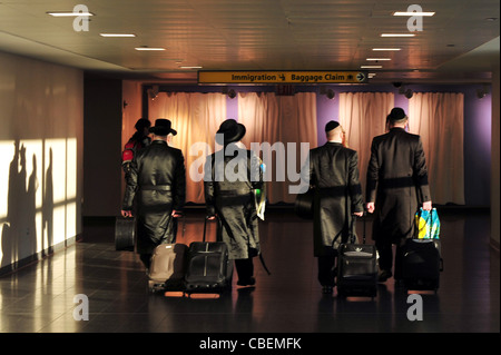 Orthodox Jewish men arriving to New York via J.F.K Airport. - Stock Photo