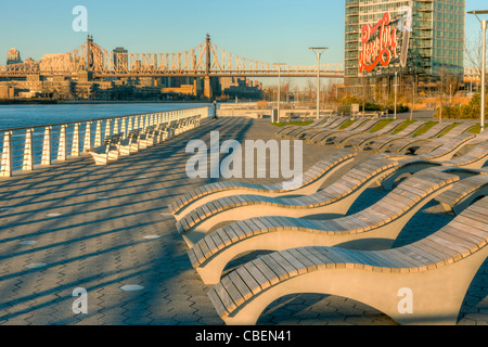 Seating with views of Manhatan and the historic Pepsi-Cola sign in Gantry Plaza State Park in Long Island City, - Stock Photo