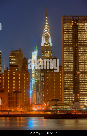 The Chrysler building and other buildings on 42nd Street in Manhattan at twilight in New York City. - Stock Photo