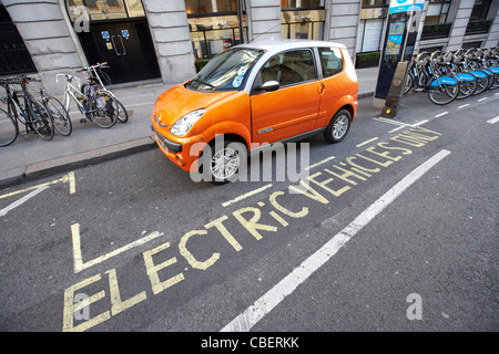 electric vehicles parking bay and car charging point london england uk united kingdom - Stock Photo