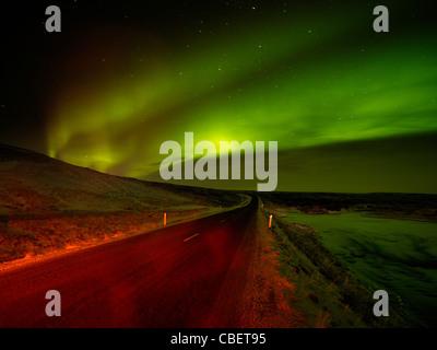 Aurora Borealis over road, Iceland - Stock Photo