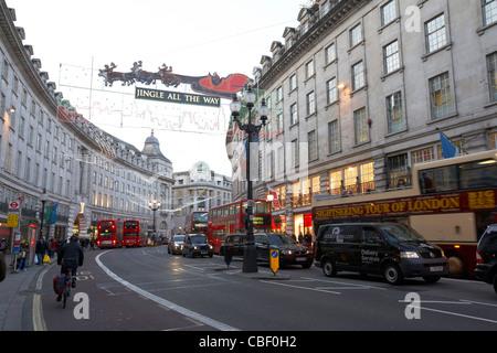 regent street on a cold december christmas shopping day london england uk united kingdom - Stock Photo