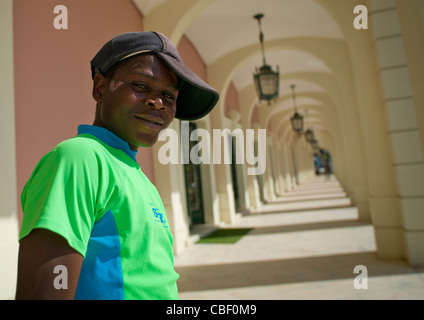 Teenager With A Cap In Front Of The National Bank Of Angola In Luanda, Angola - Stock Photo