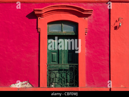 Red Facade Of An Old Colonial House In Luanda, Angola - Stock Photo