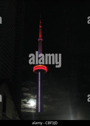 CN tower lite up at night - Stock Photo