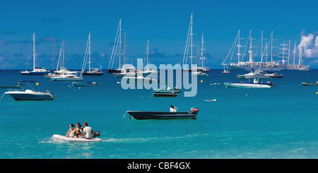 Boats in the harbor of Corossol in St Barthelemy, French West Indies. - Stock Photo