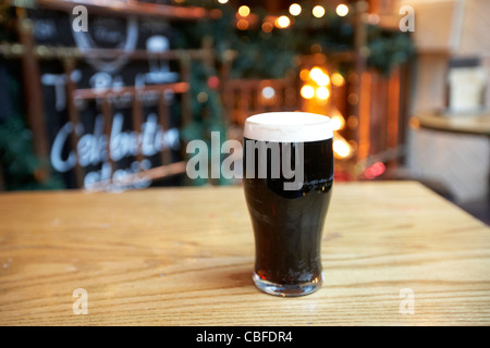 pint of stout on a table in a gastro pub london england united kingdom uk - Stock Photo