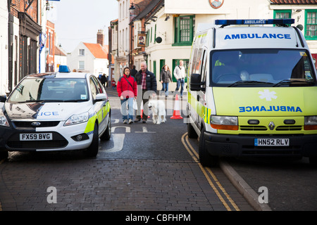 Louth Victorian Market,  Lincolnshire, England police car and ambulance parked side by side waiting for emergency - Stock Photo