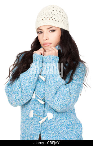 portrait of a young black hair woman in a blue wool sweater, isolated on white background - Stock Photo