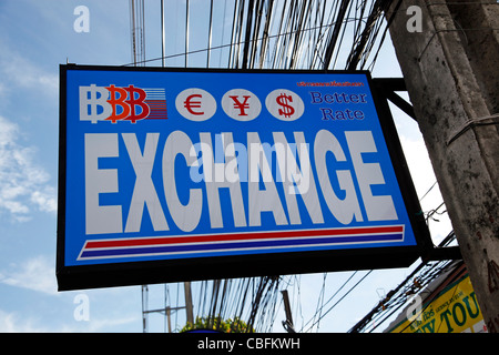 Currency exchange sign for advertising exchanging money in Patong, Phuket, Thailand - Stock Photo
