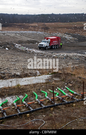 Material collected from septic tanks is injected through green pipes into St. Clair County's Smith's Creek Landfill. - Stock Photo