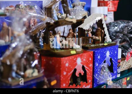 Handmade nativity scenes on sale at the Christmas market in Rynek Glowny, Krakow, Poland - Stock Photo
