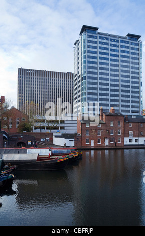 Modern Office Buildings Dwarfing the Tap and Spile Pub, Gas Street Canal Basin,  Birmingham City Centre, England, - Stock Photo