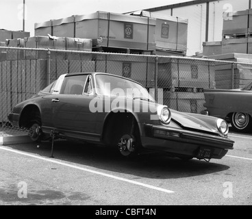 porsche carrera 1970s model parked with wheels missing german sports car - Stock Photo
