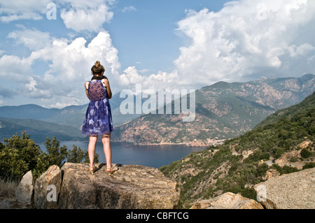 A tourist takes a photo of the Gulf of Porto from Les Calanches near the town of Piana on the west coast of the - Stock Photo