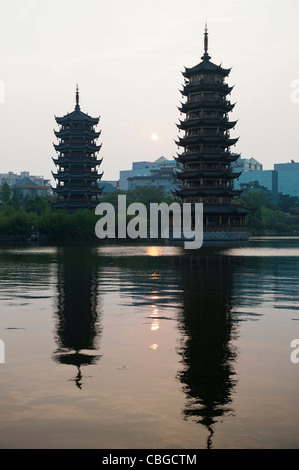 Sun and Moon Pagodas reflected over Banyan lake - Stock Photo
