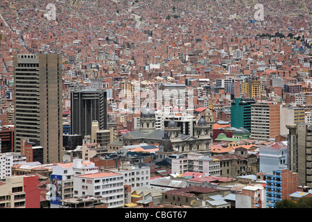 View over skyscrapers and flats in the city La Paz and the San Francisco Cathedral, Bolivia - Stock Photo