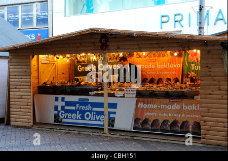 christmas market stall selling fresh greek olives - Stock Photo