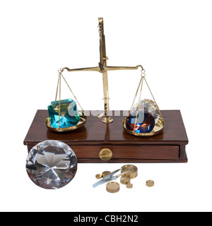 Weighing gems on a brass and wood scale - path included - Stock Photo
