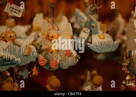 Various Christmas tree ornaments displayed for sale at the Christmas Market in Leipzig, Germany. - Stock Photo